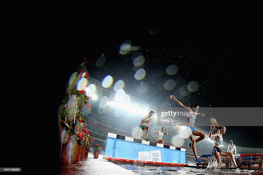Athletes compete in Women's 2000m Steeplechase Final during day nine of Nanjing 2014 Summer Youth Olympic Games at the Nanjing Olympic Sports Centre on August 25, 2014 in Nanjing, China.