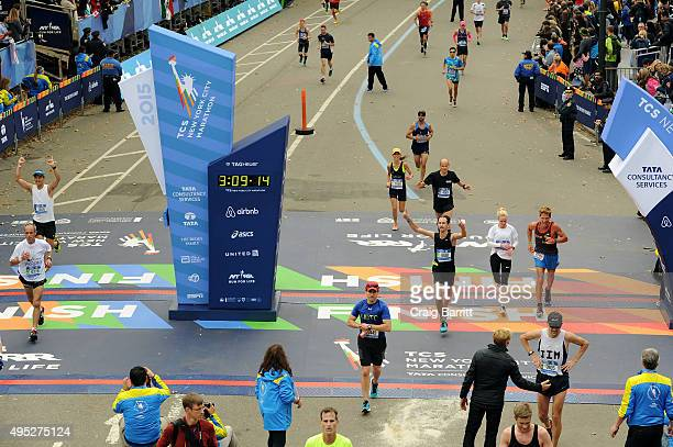 Athletes cross the finish line at TAG Heuer Official Timekeeper and Timepiece of 2015 TCS New York City Marathon on November 1 2015 in New York City