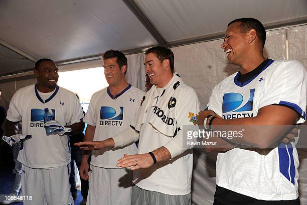 Athletes Darren Woodson Jesse Palmer Colt McCoy and Alex Rodriguez pose during DIRECTV's Fifth Annual Celebrity Beach Bowl at Victory Park on...