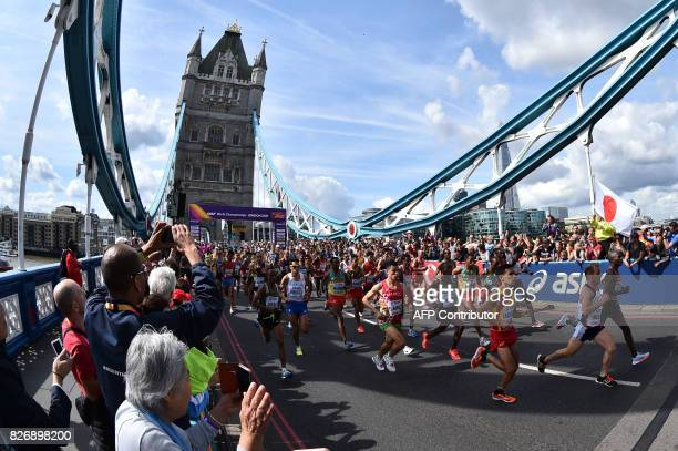TOPSHOT Athletes depart from Tower Bridge at the start of the men's marathon athletics event at the 2017 IAAF World Championships in central London...