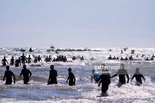Athletes dive into the sea and start the swim leg of Ironman 703 Italy race on June 18 2017 in Pescara Italy