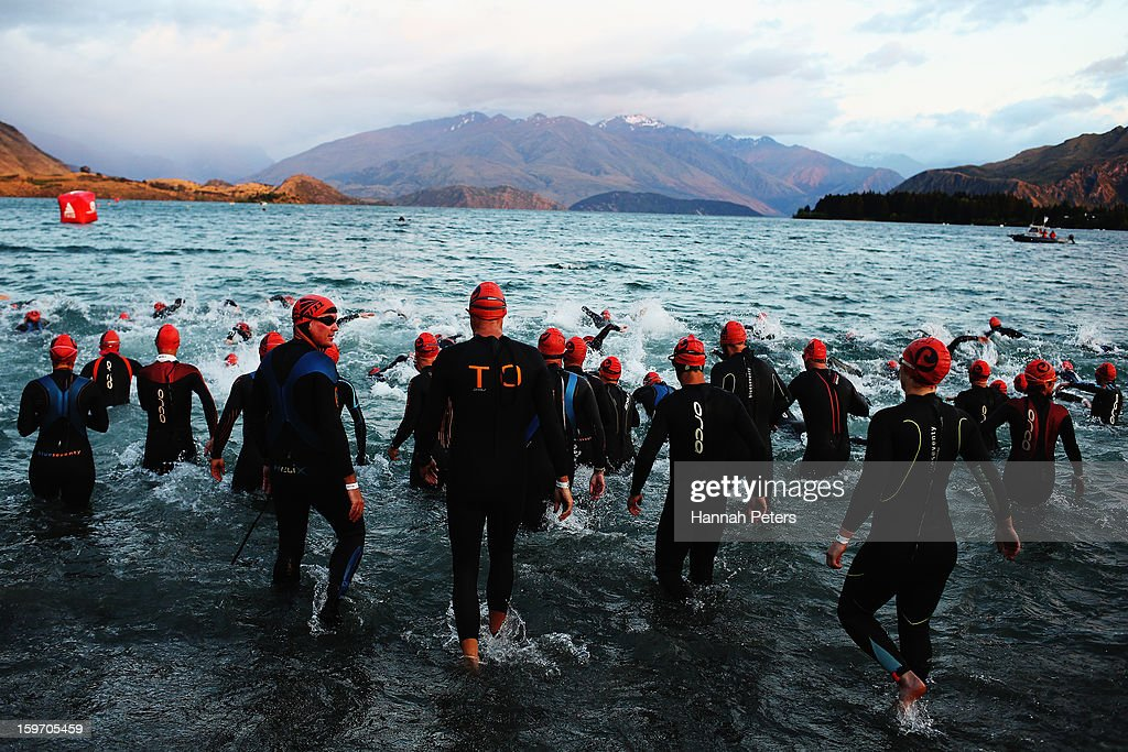 Athletes enter the water before taking part in the Challenge Wanaka on January 19, 2013 in Wanaka, New Zealand.