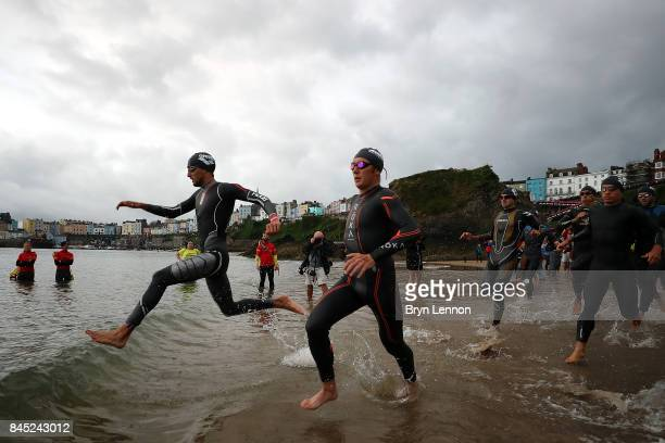 Athletes enter the water for the swim leg of IRONMAN Wales on September 10 2017 in Tenby Wales