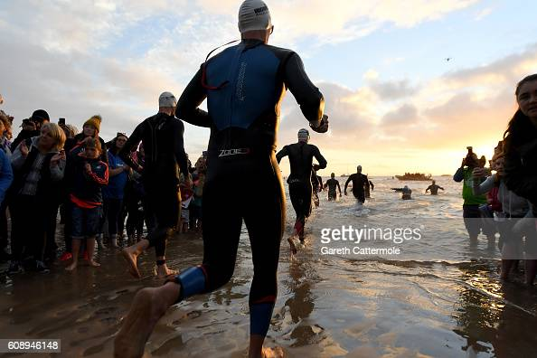 Athletes enter the water for the swim section of Ironman Wales on September 18 2016 in Pembroke Wales