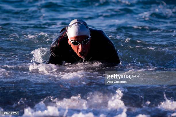 Athletes exit the water after completing the swim leg of Ironman 703 Barcelona race on May 21 2017 in Barcelona Spain