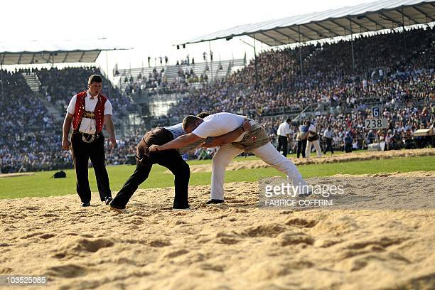 Athletes fight during the opening day of the Federal Alpine Wrestling Festival on August 21 2010 in Frauenfeld east of Switzerland More than 200 000...