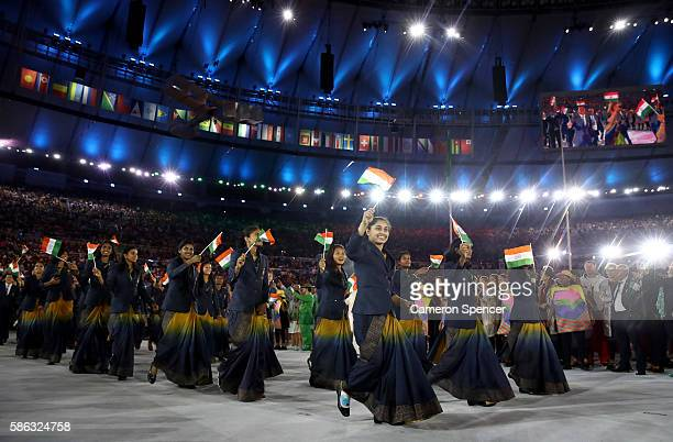 Athletes from India enter the stadium during the Opening Ceremony of the Rio 2016 Olympic Games at Maracana Stadium on August 5 2016 in Rio de...