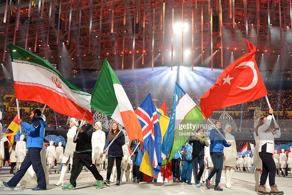 Iran, Ireland, Iceland,Uzbekistan and Turkey carry their national flags as they take part in the Closing Ceremony of the Sochi Winter Olympics at the Fisht Olympic Stadium on February 23, 2014.