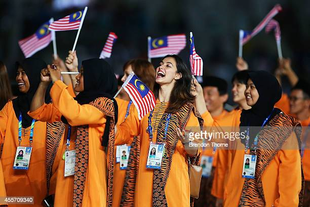 Athletes from Malaysia arrive during the Opening Ceremony ahead of the 2014 Asian Games at Incheon Asiad Main Stadium on September 19 2014 in Incheon...