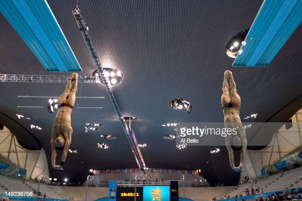 Athletes from Malaysia practice synchronized diving during a training session ahead of the London Olympic Games at the Aquatics Centre in Olympic...