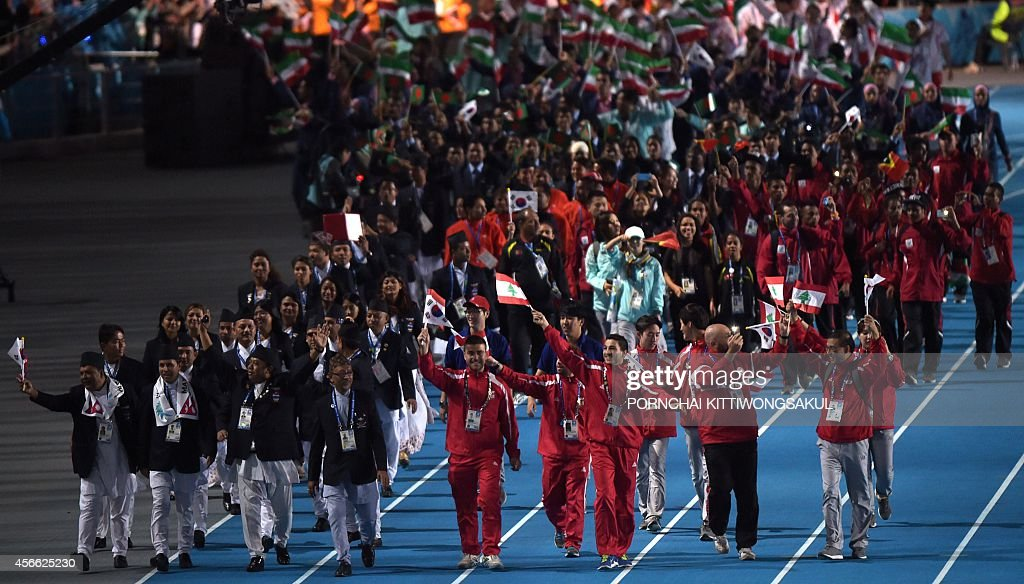 Athletes from Nepal and Lebanon lead the parade of competitors during the closing ceremony of the 2014 Asian Games at The Incheon Asiad Main Stadium...