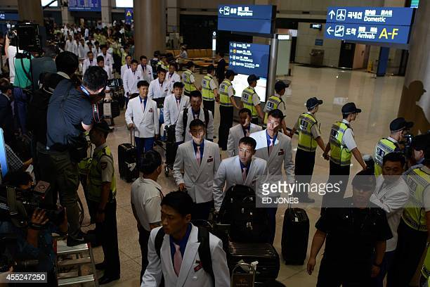 Athletes from North Korea arrive at Incheon international airport ahead of competing at the Asian Games on September 11 2014 A first batch of North...