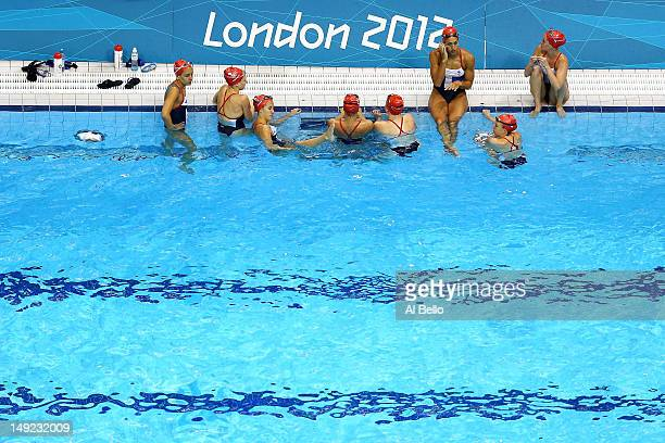 Athletes from the Great Britain Women's Synchronised Swimming team take a break in the pool during a training session ahead of the London Olympic...