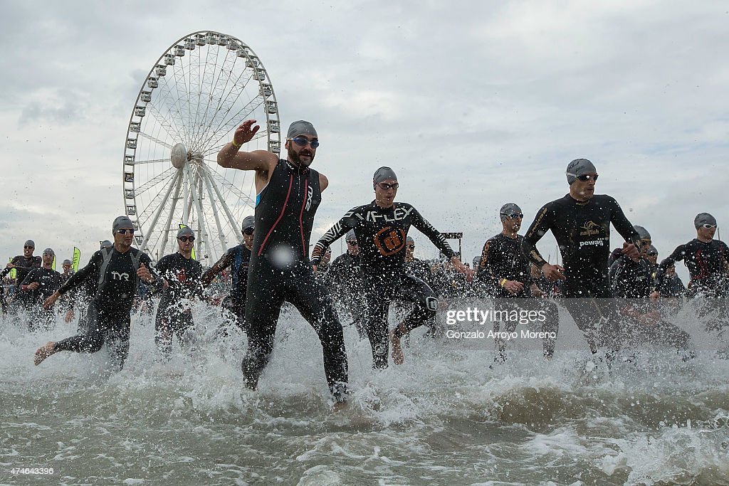 Athletes get inside the water at the starting point of the swimming course during the 2015 ETU Challenge Rimini European Championship Half Distance...