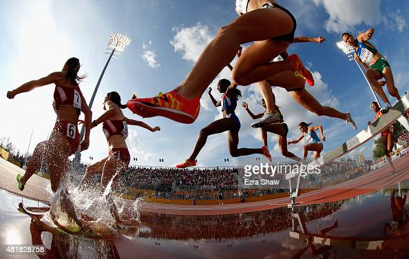 Athletes go over the water jump during the women's 3000 meter steeplechase during Day 14 of the Toronto 2015 Pan Am Games on July 24 2015 in Toronto...