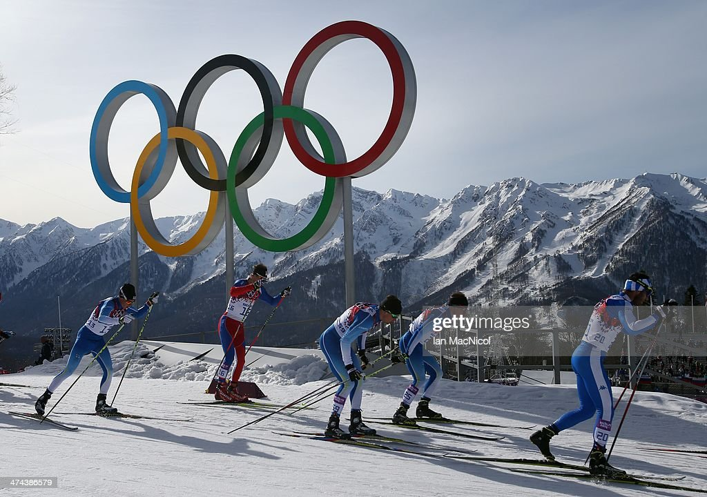 Athletes go past the Olympic rings as they compete in the Men's 50km Mass Start Free on Day 16 of the Sochi 2014 Winter Olympics at Laura Cross-country Ski & Biathlon Center on February 23, 2014 in Sochi, Russia.