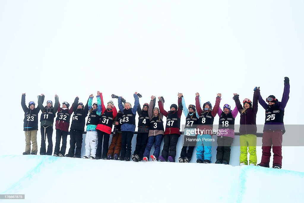 Athletes have fun in the snow as they wait for the FIS Snowboard Slopestyle World Cup Womens Finals to start during day five of the Winter Games NZ at Cardrona Alpine Resort on August 19, 2013 in Wanaka, New Zealand.