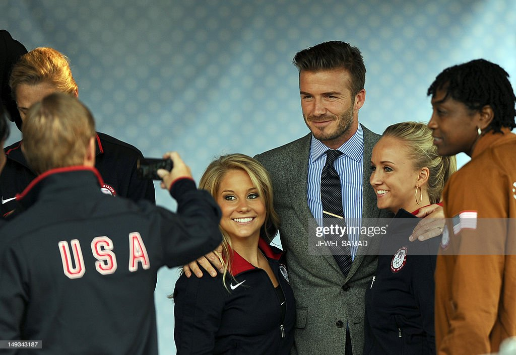 US athletes have their picture taken with British footballer David Beckham during US First Lady Michelle Obama's 'Let's Move-London' event at the Winfield House in London on July 27, 2012, hours before the official start of the London 2012 Olympic Games.