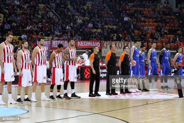 Athletes hold a minute of silence in memory of the victims of the recent floods of Athens and of the Euroleague referee Gianluca Mattioli during the...