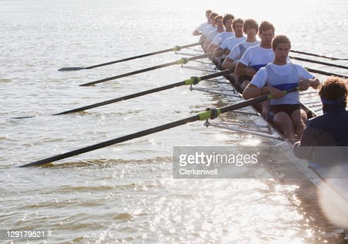 Athletes in a crew canoe