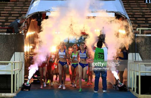 Athletes in the girls 2000m steeplechase make thier way out to the track on day three of the IAAF U18 World Championships at the Kasarani Stadium on...