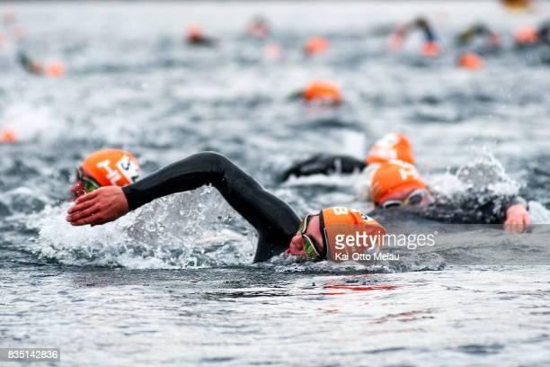 Athletes in the water at The Arctic Triple // Lofoten Triathlon Olympic distance on August 18 2017 in Svolvar Norway Lofoten Triathlon is one of...