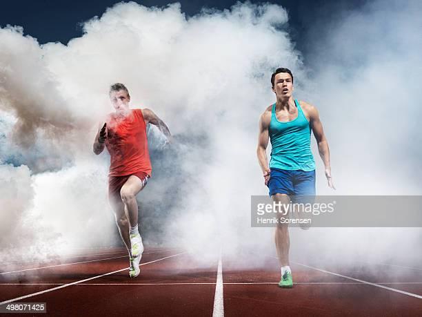 2 athletes in white smoke