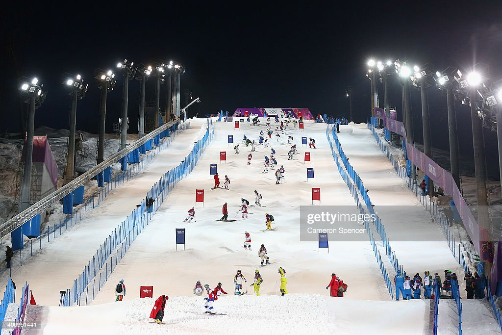 Athletes inspect the course during moguls practice at the Extreme Park at Rosa Khutor Mountain ahead of the Sochi 2014 Winter Olympics on February 5, 2014 in Sochi, Russia