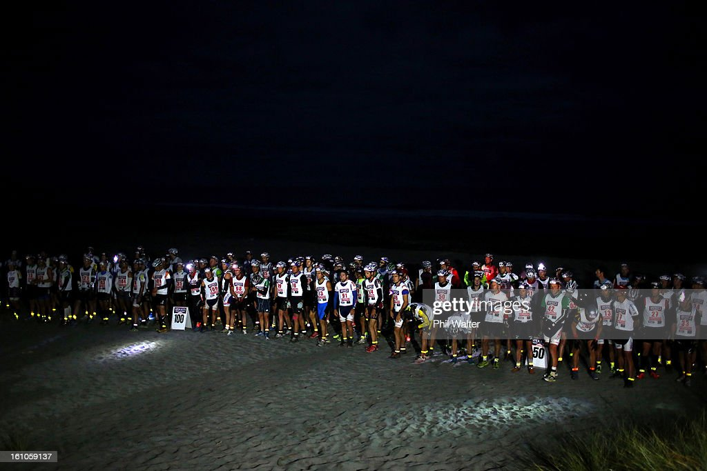 Athletes line up on Kumara beach for the start of the one day individual event during the 2013 Speights Coast to Coast on February 9, 2013 in Christchurch, New Zealand.