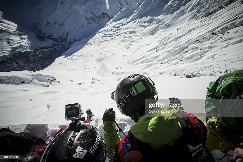 Athletes look down from the top of the run during day 1 of the Swatch Skiers Cup on February 10, 2013 in Zermatt, Switzerland.