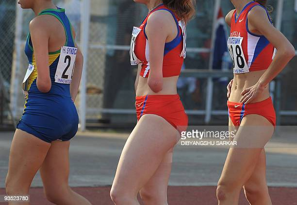 Athletes look on after competing in the T46 class 100 m sprint at the Sree Kanteerava Stadium in Bangalore on November 27 2009 More than 800 athletes...