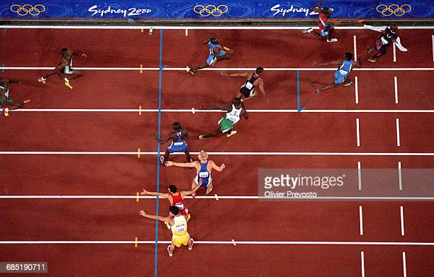 Athletes make a hand off to the next runner in the women's 4x400m relay final of the 2000 Olympics