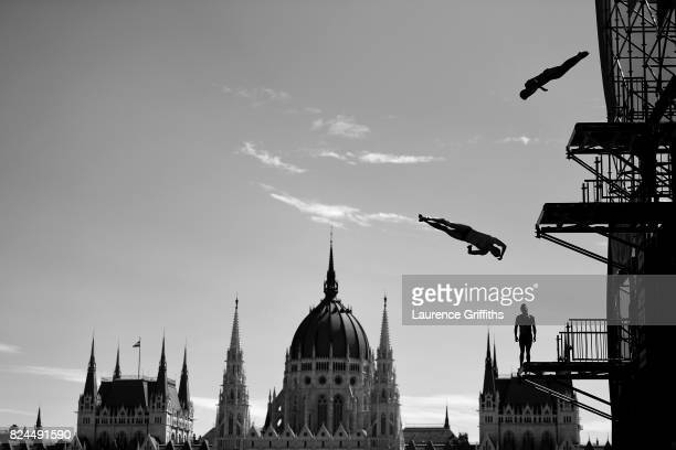 Athletes make a practice dive prior to the Men's High dive on day seventeen of the Budapest 2017 FINA World Championships on on July 30 2017 in...