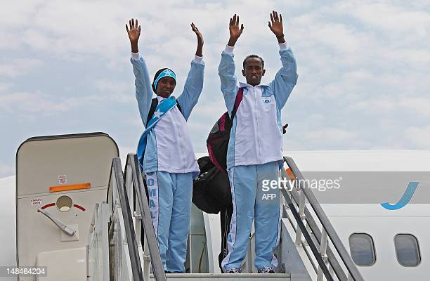 Athletes Mohamed Hassan Mohamed who will compete in the 1500m race and Zamzam Mahmuud Farah who will compete in the 800m race wave at fans as they...