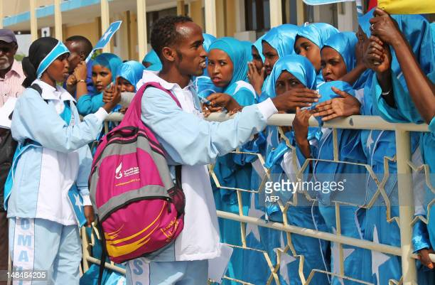 Athletes Mohamed Hassan Mohamed who will compete in the 1500m race and Zamzam Mahmuud Farah who will compete in the 800m race greet fans before...