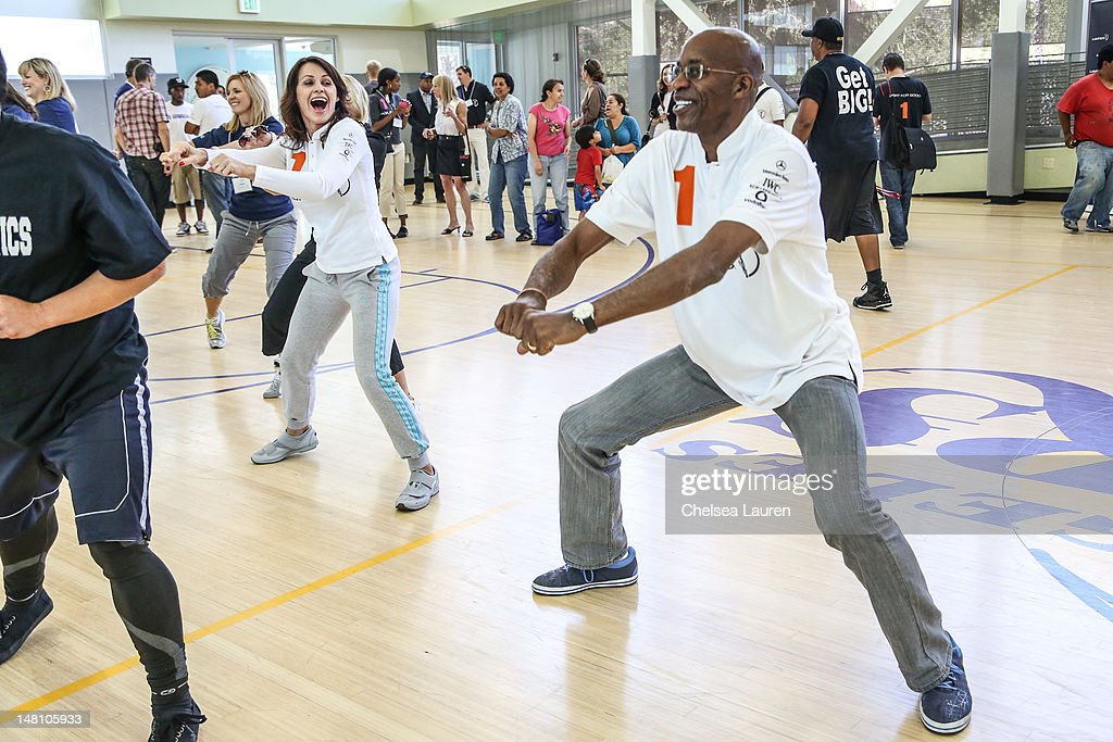 Athletes Nadia Comaneci and Edwin Moses participate in the MercedesBenz USA Laureus Los Angeles launch on July 9 2012 in Los Angeles California