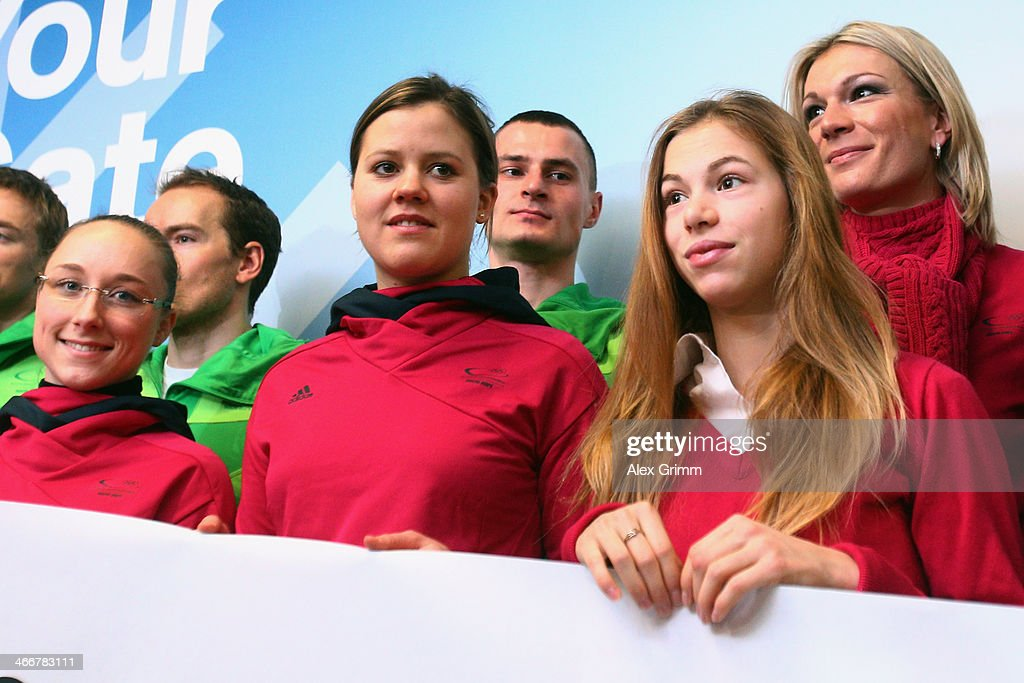 Athletes <a gi-track='captionPersonalityLinkClicked' href=/galleries/search?phrase=Nathalie+Weinzierl&family=editorial&specificpeople=8823412 ng-click='$event.stopPropagation()'>Nathalie Weinzierl</a>, <a gi-track='captionPersonalityLinkClicked' href=/galleries/search?phrase=Viktoria+Rebensburg&family=editorial&specificpeople=4152387 ng-click='$event.stopPropagation()'>Viktoria Rebensburg</a>, Robert Seifert, Anna Seidel and <a gi-track='captionPersonalityLinkClicked' href=/galleries/search?phrase=Maria+Hoefl-Riesch&family=editorial&specificpeople=7648886 ng-click='$event.stopPropagation()'>Maria Hoefl-Riesch</a> pose as Team Germany departs to the Sochi 2014 Winter Olympics from Frankfurt international airport on February 4, 2014 in Frankfurt am Main, Germany.