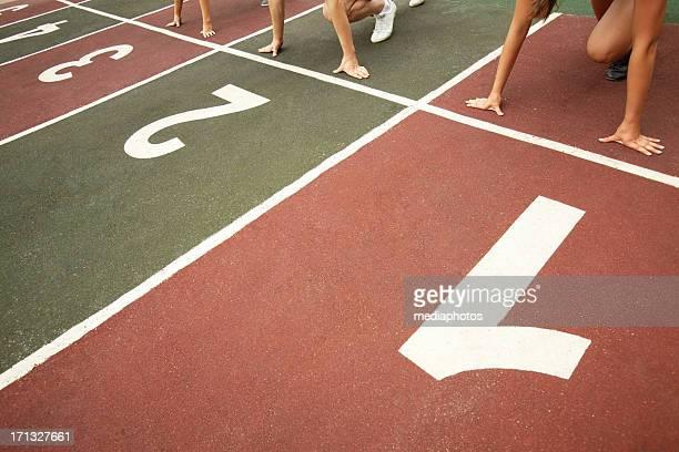 Athletes on run tracks