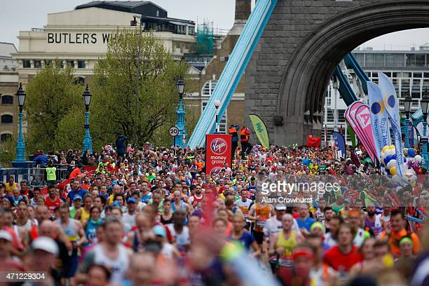 Athletes on the north side of Tower Bridge during the Virgin Money London Marathon on April 26 2015 in London England