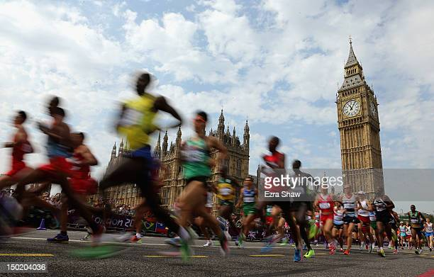 Athletes pass the Palace of Westminster as they compete in the Men's Marathon on Day 16 of the London 2012 Olympic Games on the streets of London on...