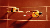 Athletes passing baton in relay  race, overhead, (Digital Composite)