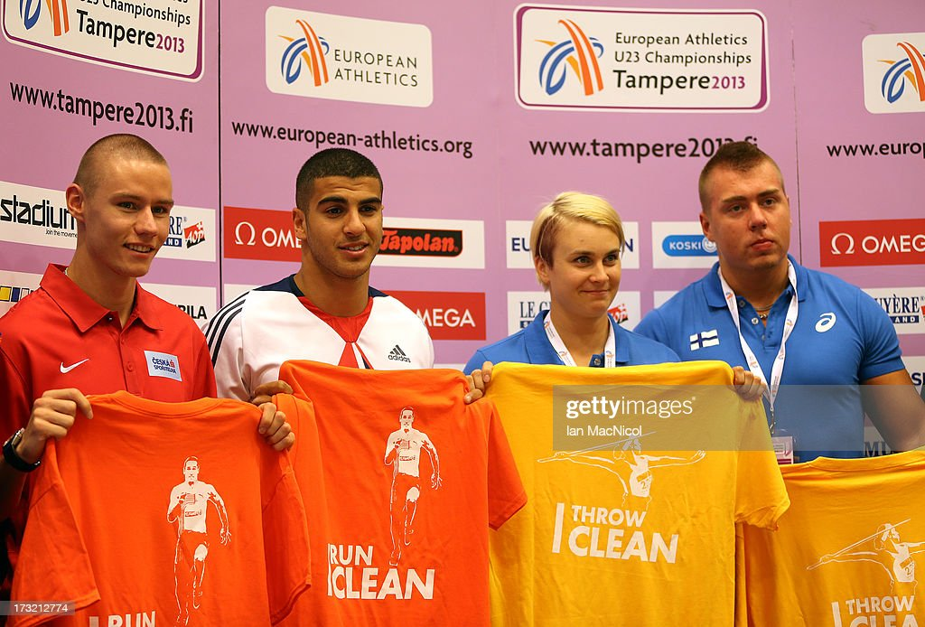 Athletes Pavel Maslak, <a gi-track='captionPersonalityLinkClicked' href=/galleries/search?phrase=Adam+Gemili&family=editorial&specificpeople=7091483 ng-click='$event.stopPropagation()'>Adam Gemili</a>, Sanni Utrianen and Attu Kangas display T shirts which are supporting an anti doping campaign during the press conference prior to The European Athletics U23 Championships 2013 fly in The Market Square on July 10, 2013 in Tampere, Finland.