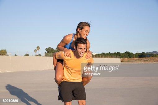 'Athletes playing piggyback, Van Nuys, California, USA'
