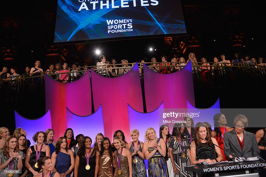 Athletes pose during the grand march at the 33rd Annual Salute To Women In Sports Gala post reception at Cipriani Wall Street on October 17, 2012 in New York City.