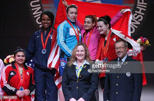 Athletes pose for a group picture after the Women's 75kg event during day six of the 2013 Junior Weightlifting World Championship at Maria Angola...