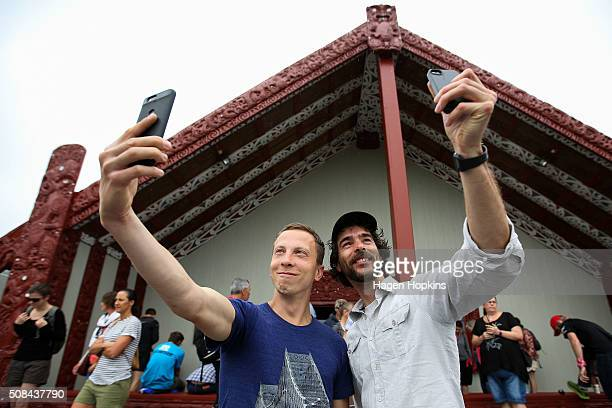 Athletes pose for a selfie during the official race welcome for the Tarawera Ultramarathon at Te Aronui a Rua Marae on February 5 2016 in Rotorua New...
