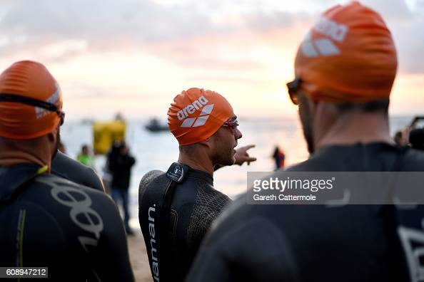 Athletes prepare to enter the water for the swim section of Ironman Wales on September 18 2016 in Pembroke Wales