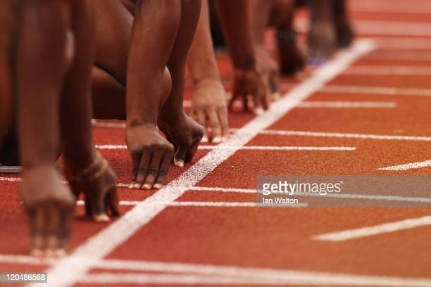 Athletes prepare to run in the Womens 100m Final during the Aviva London Grand Prix at Crystal Palace on August 6 2011 in London England