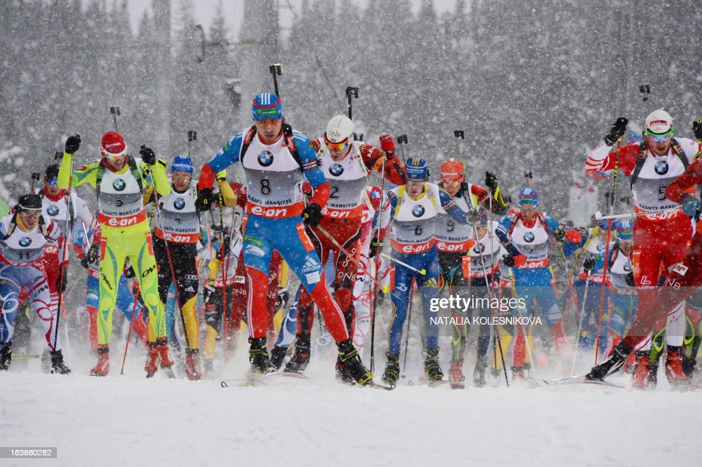 Athletes race during the men's 15 km mass start event of the IBU Biathlon Word Cup in the Siberian city of Khanty-Mansiysk, on March 17, 2013. France's Martin Fourcade took first place ahead of Austria's Dominik Landertinger and Norway's Emil Hegle Svendsen.