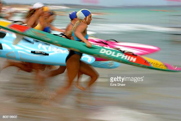 Athletes race to the the water in during the start of the female board race during day four of the 2008 Australian Surf Lifesaving Championships held...